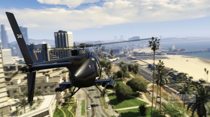 Hellicopter fly over the beach